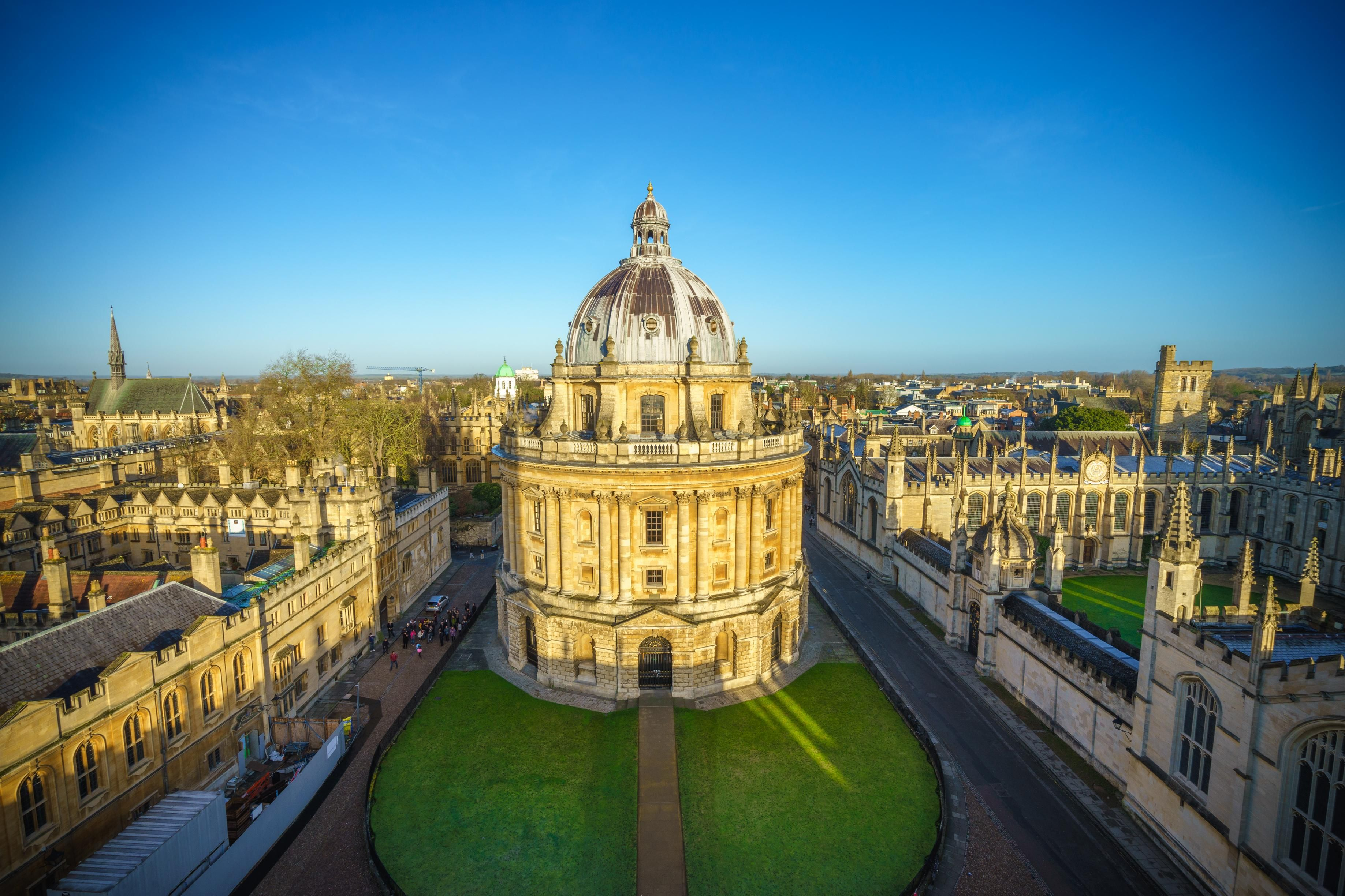 Aerial view of the Oxford University City viewed from the top tower of St Marys Church at sunrise. All Souls College, United Kingdom, England. Panoramic view